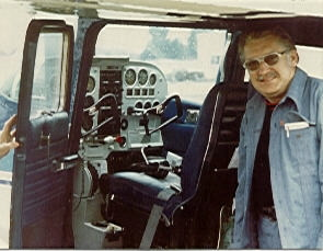 Claude standing by the cockpit of his single engine Cessna.