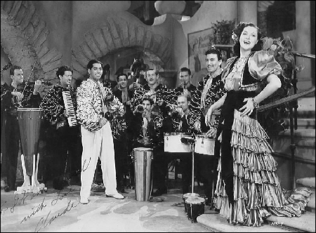 Claude appears playing his accordion in this 1939 motion picture musical An Old Spanish Custom, later renamed In Rhumba Land, featuring the Darryl Harpa Orchestra and celebrated singer, Wini Shaw.  (Released through Universal Studios. Still searching for a film copy, please help.)