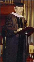 Claude giving acceptance speech for his doctorate on June 24, 1992